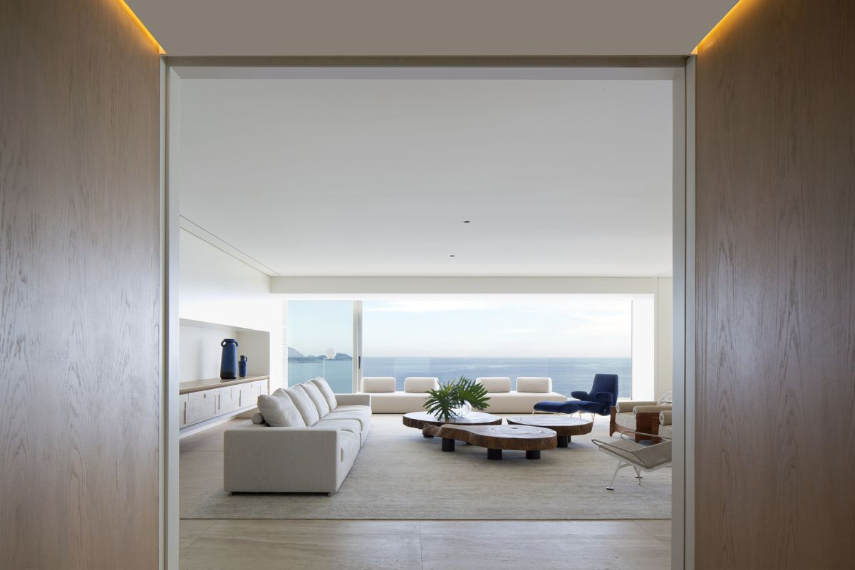 The living area opens onto a balcony which overlooks the ocean
