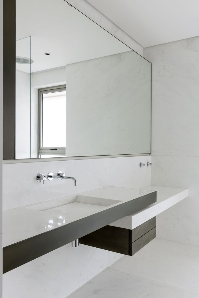 Large mirrors reflect the views and give the bathrooms a very bright and airy feel