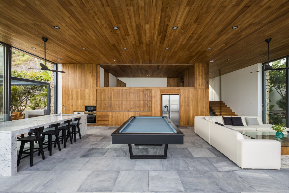 It's not just the exterior of the house that's infused with wood but also the interior where the timber adds a warm touch to the decor