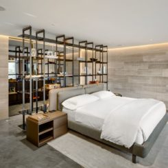 Modern bedroom with large standing shelving unit