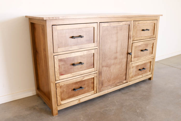 Wooden dresser with shelved in the middle and drawers on the sides