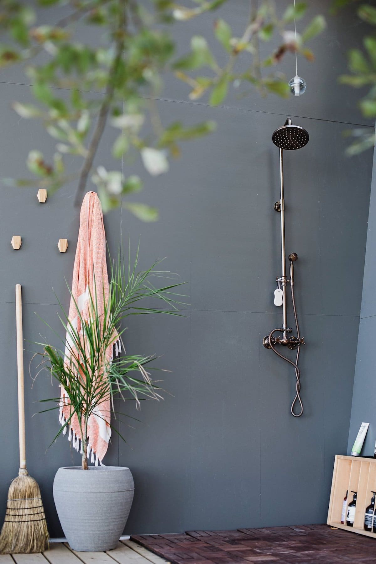 An outdoor shower is tucked away on one side of the patio and was one of the features requested by the owners