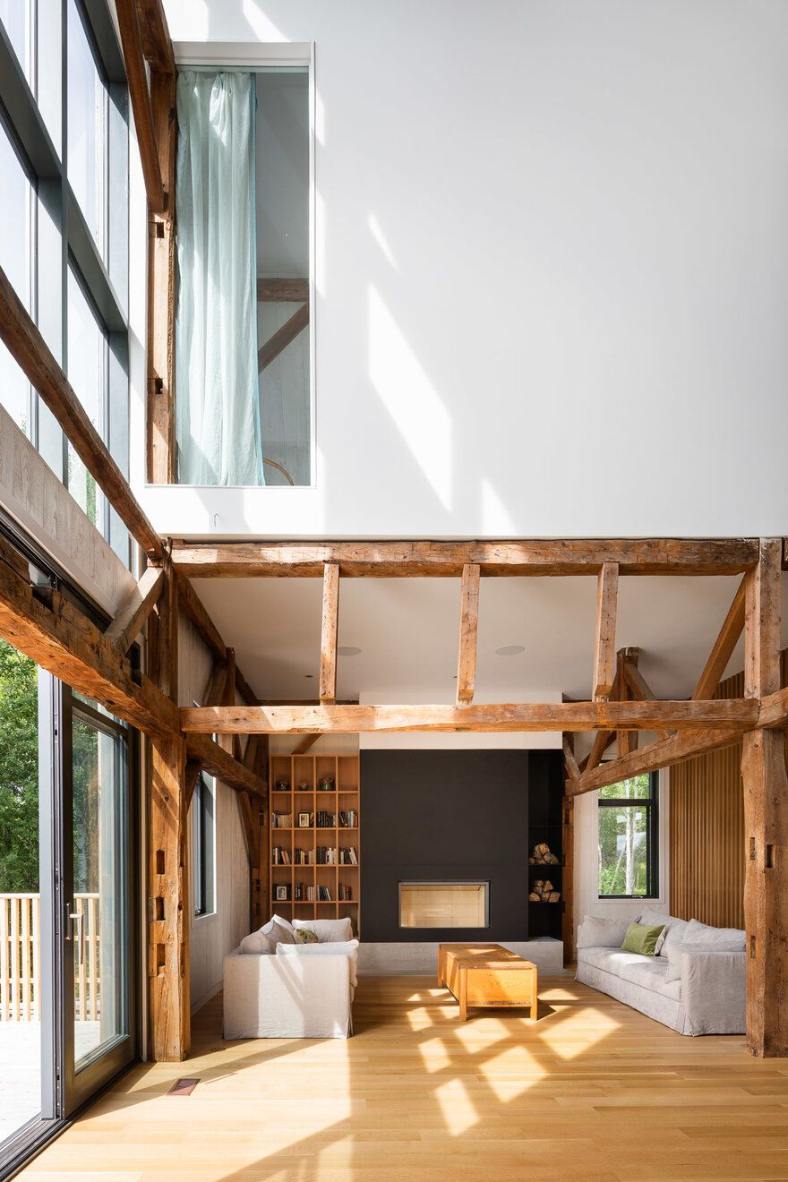 The social area positioned at the center of the house has a 30 foot tall ceiling and large windows