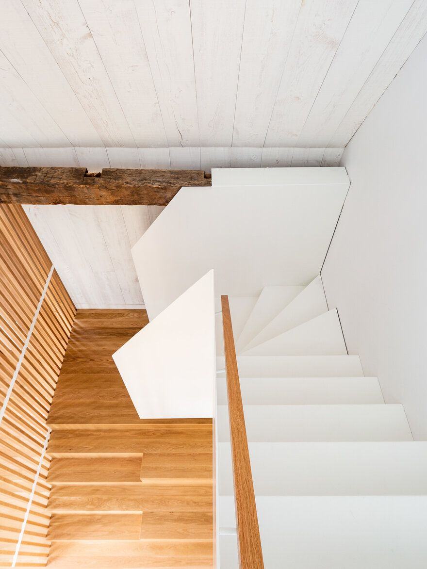 The two staircase feature very different styles but actually complement one another nicely