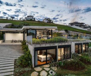 Contemporary House Makes Clever Use Of A Steep Slope With Nice Views