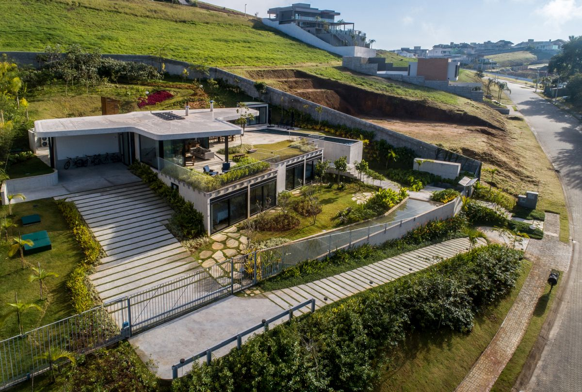 The house appears to dig into the slope when in fact it rises above the landscape