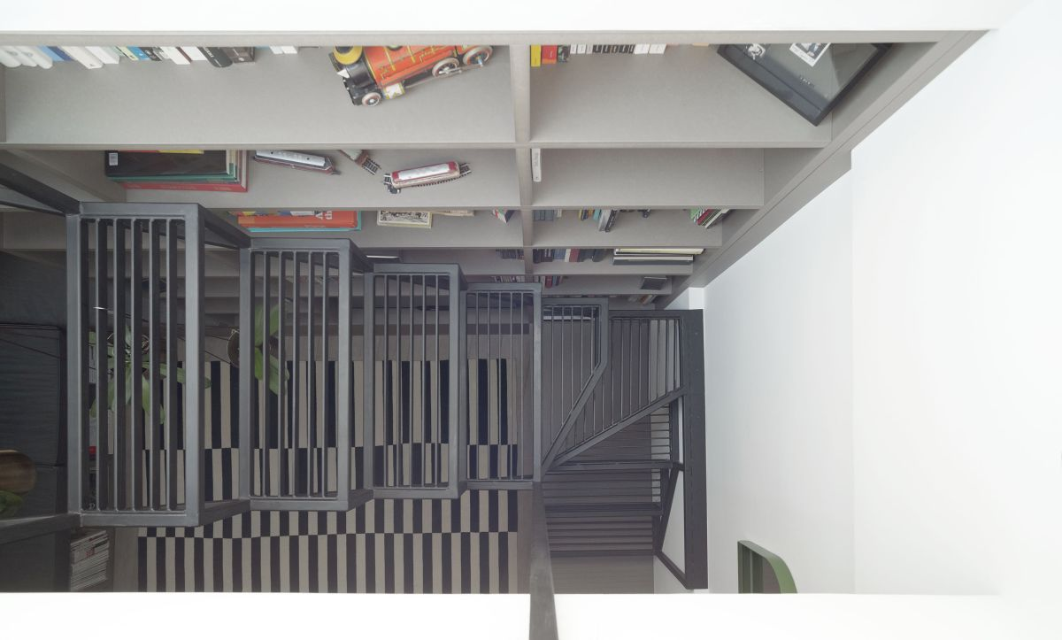 The custom living room unit includes a set of iron stairs which leads up to the roof terrace