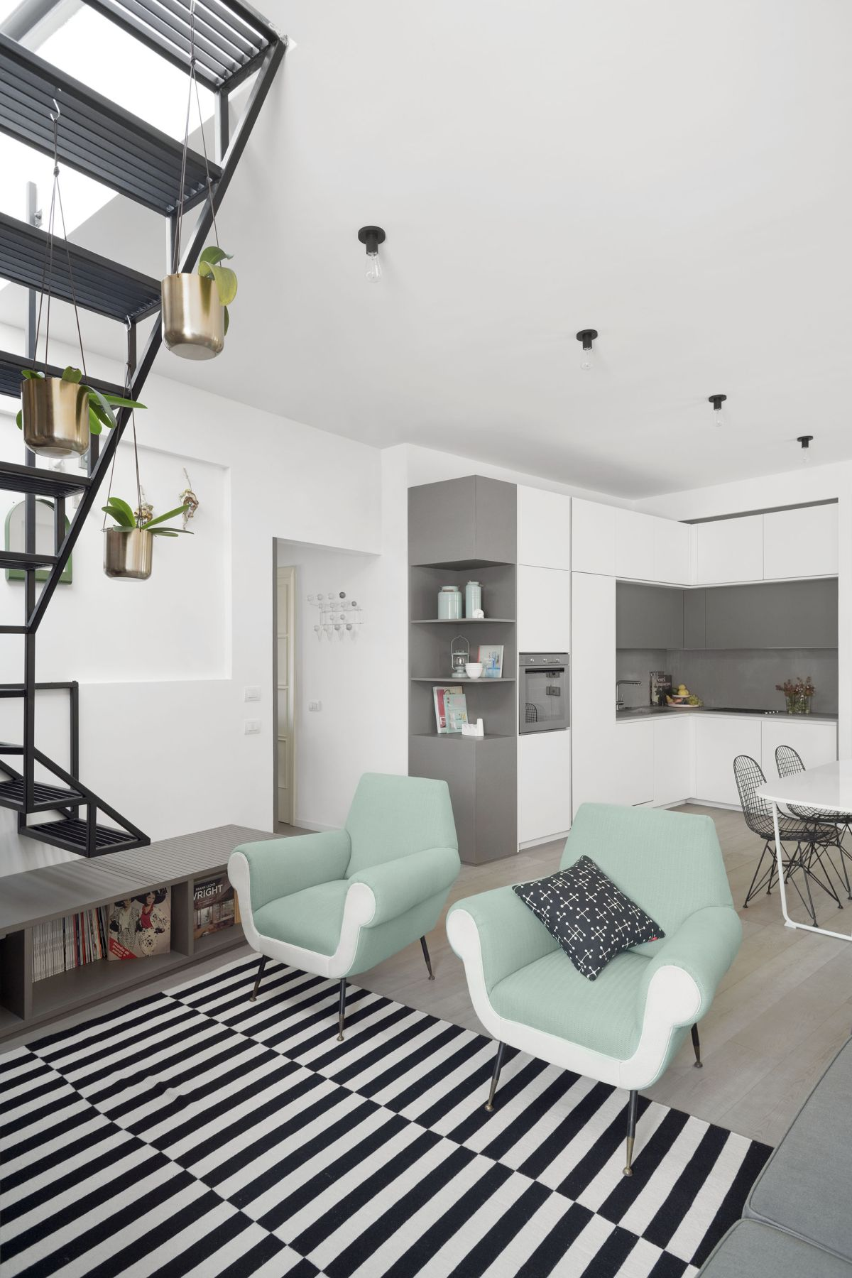 The soft grey of the custom unit is repeated throughout the apartment in various forms and proportions