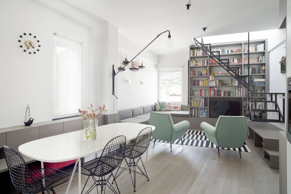 The living room, kitchen and dining area share a single open space but are fairly clearly delineated