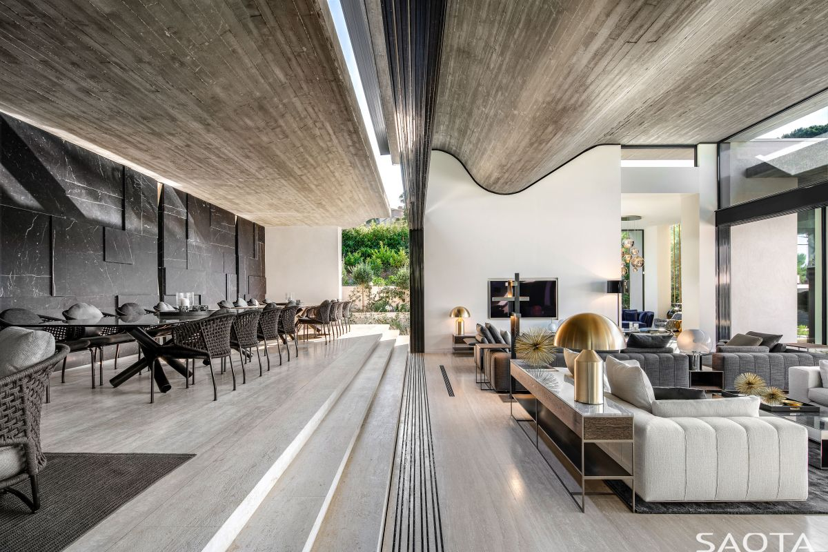 This central section houses the entertainment areas and main living space