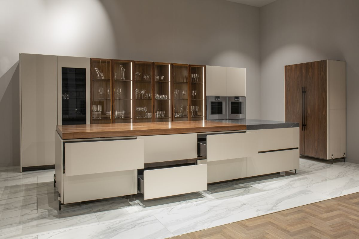 The island is one of the key elements, incorporating a variety of functions within a sleek and very elegant shell