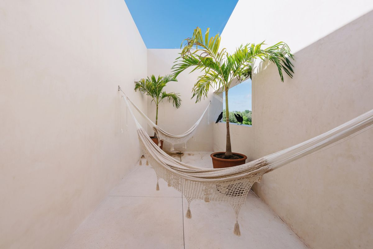 The other sections of the house enjoy their own special connection with the outdoors in the form of individual little courtyards