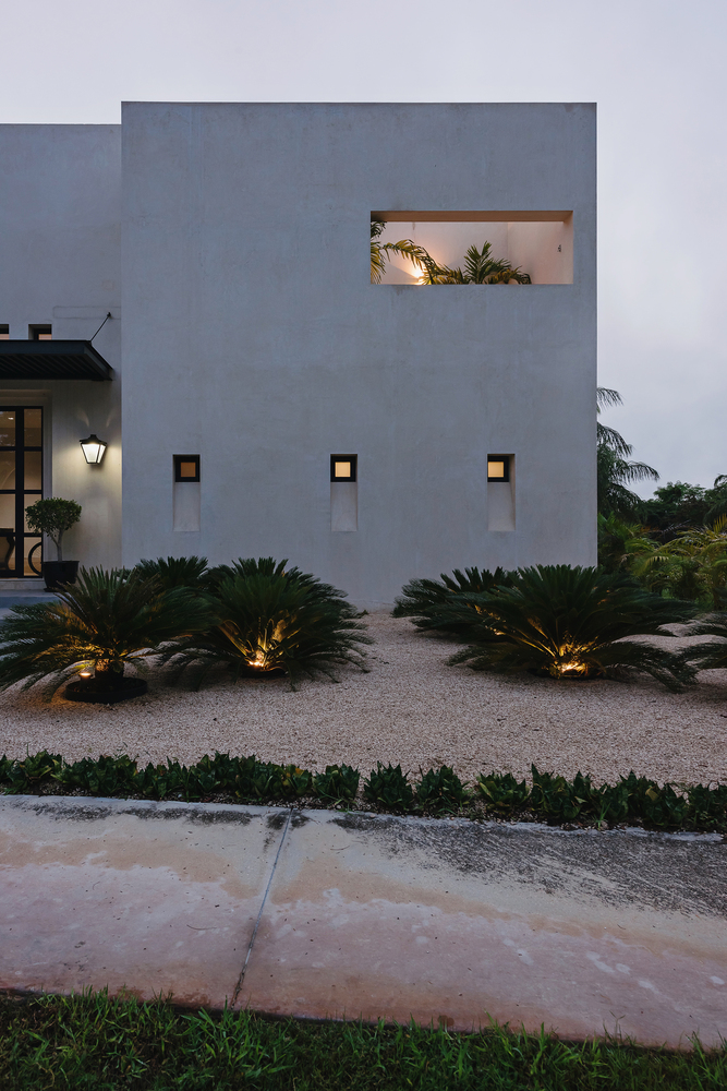 Ambient lights have been seamlessly embedded into the landscape, adding curb appeal