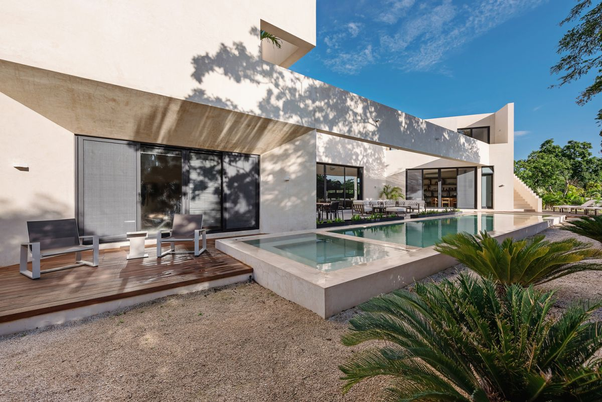 A smaller slightly elevated terrace sits in the continuation of the pool, complementing it