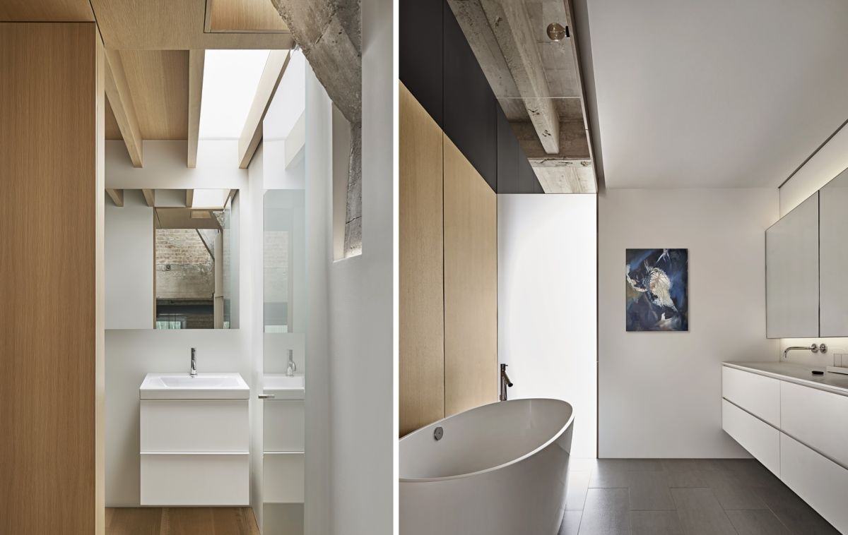 The bathroom spaces are small, minimalist and defined by a modern aesthetic