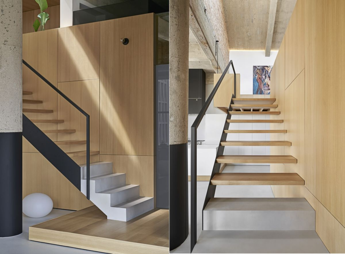 The loft area can be accessed via a staircase made of metal, wood and concrete