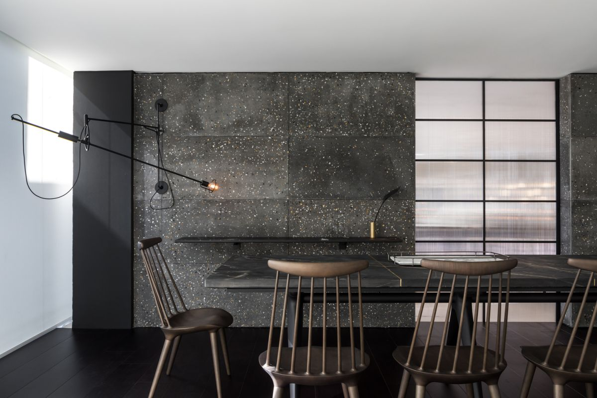 This accent wall built using concrete boards is a source of masculinity for the entire decor