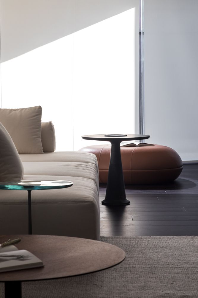There are lots of soft curves, delicate angles and elegant finishes throughout the apartment