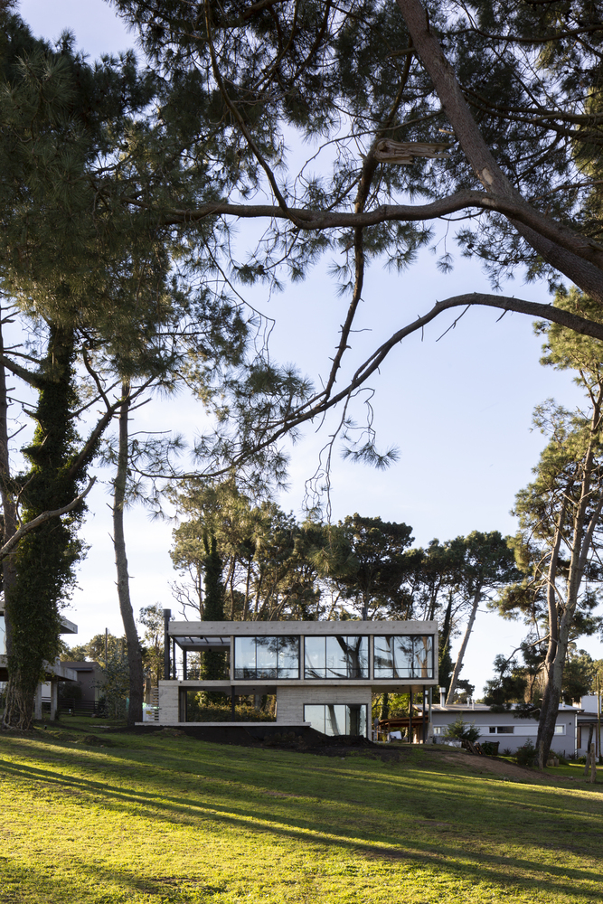 Even though it has a solid concrete base, the house still manages to look as if it's floating above the ground