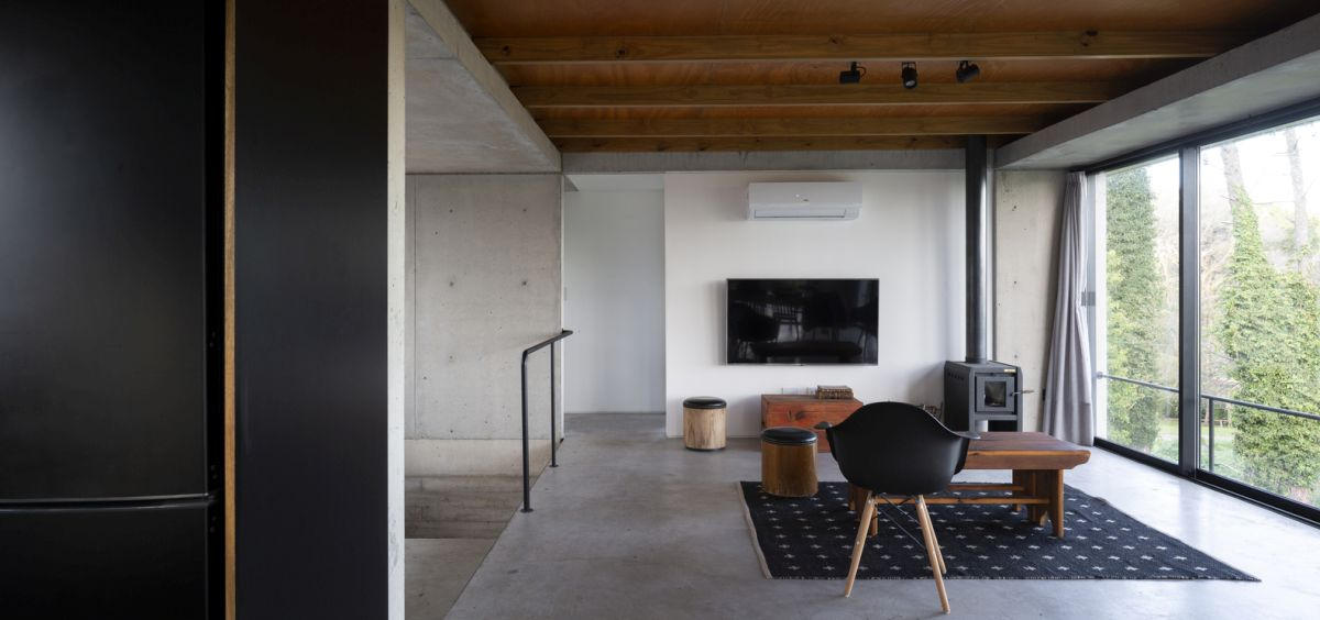 The interior staircase acts as a divider between different areas of the house