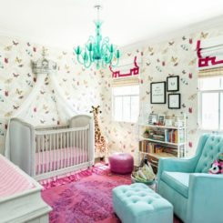 Pink gril nursery room with glider