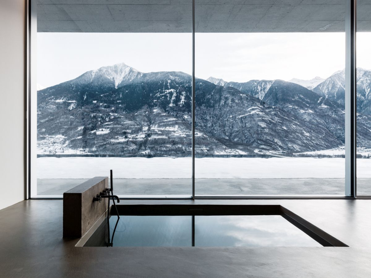 The frameless windows and sliding doors look very sleek and maximize the views