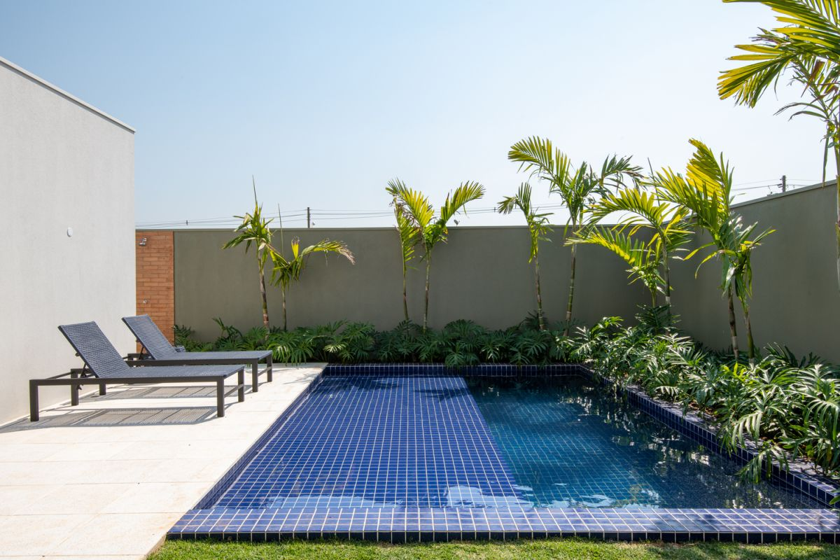 The swimming pool and adjacent deck occupy this corner and are framed by privacy walls
