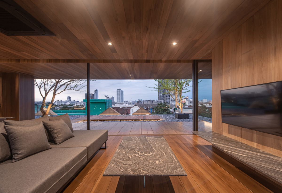 Full-height windows and glass doors provide panoramic views and give the illusion of a larger space