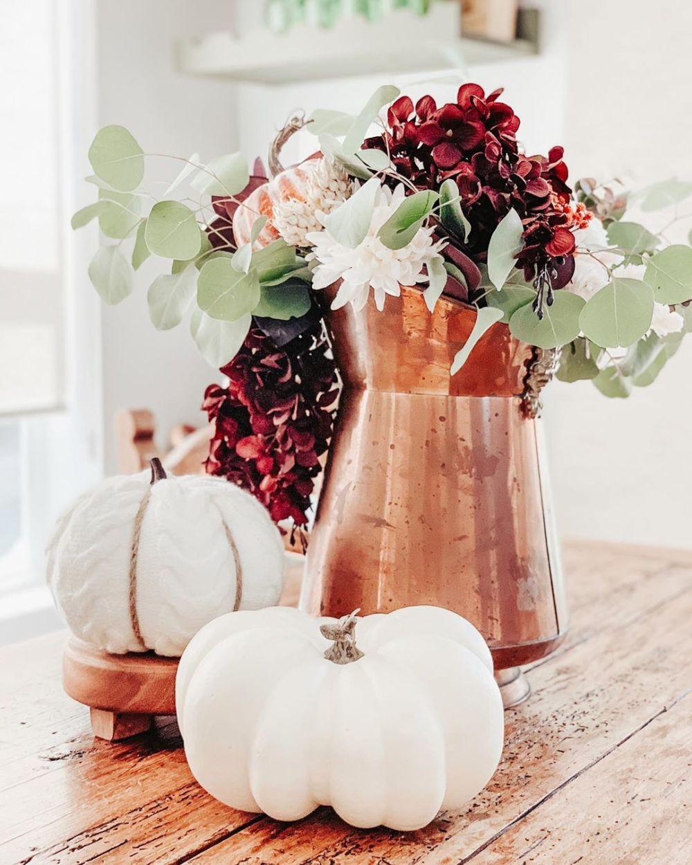 White Pumpkins with Seasonal Foliage