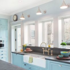 Turquoise kitchen lighting from Hudson valley on the wall