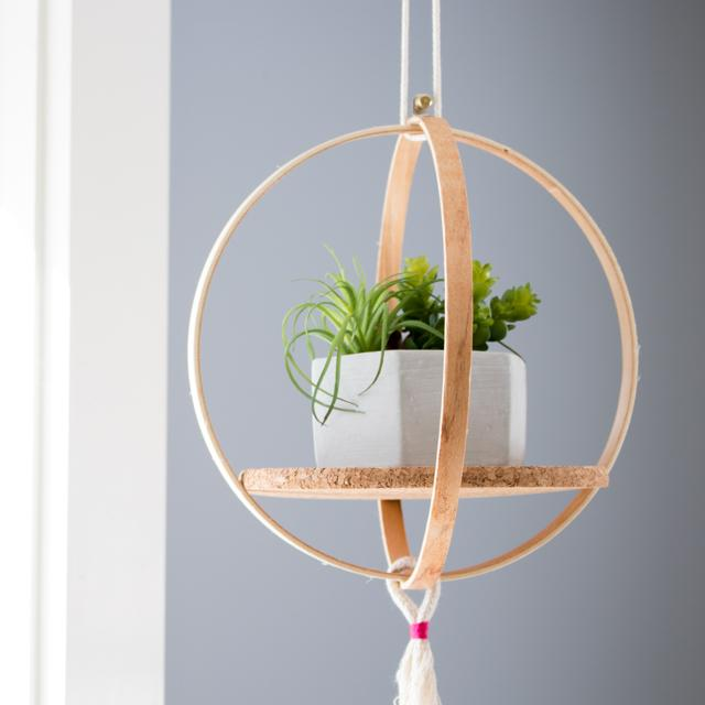 A bubble shelf made of repurposed embroidery hoops