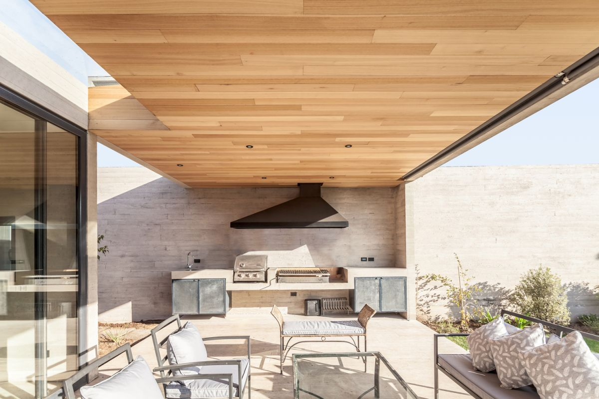 The outdoor kitchen serves as an extension of the indoor living area
