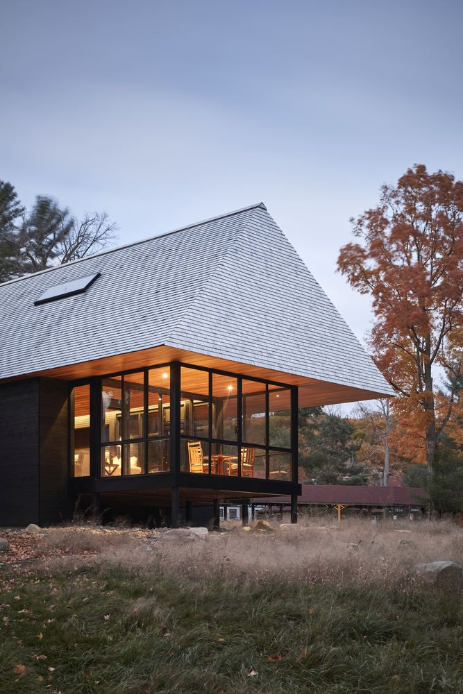 The design of the roof is distinctive, referencing the big historic cottages from this region