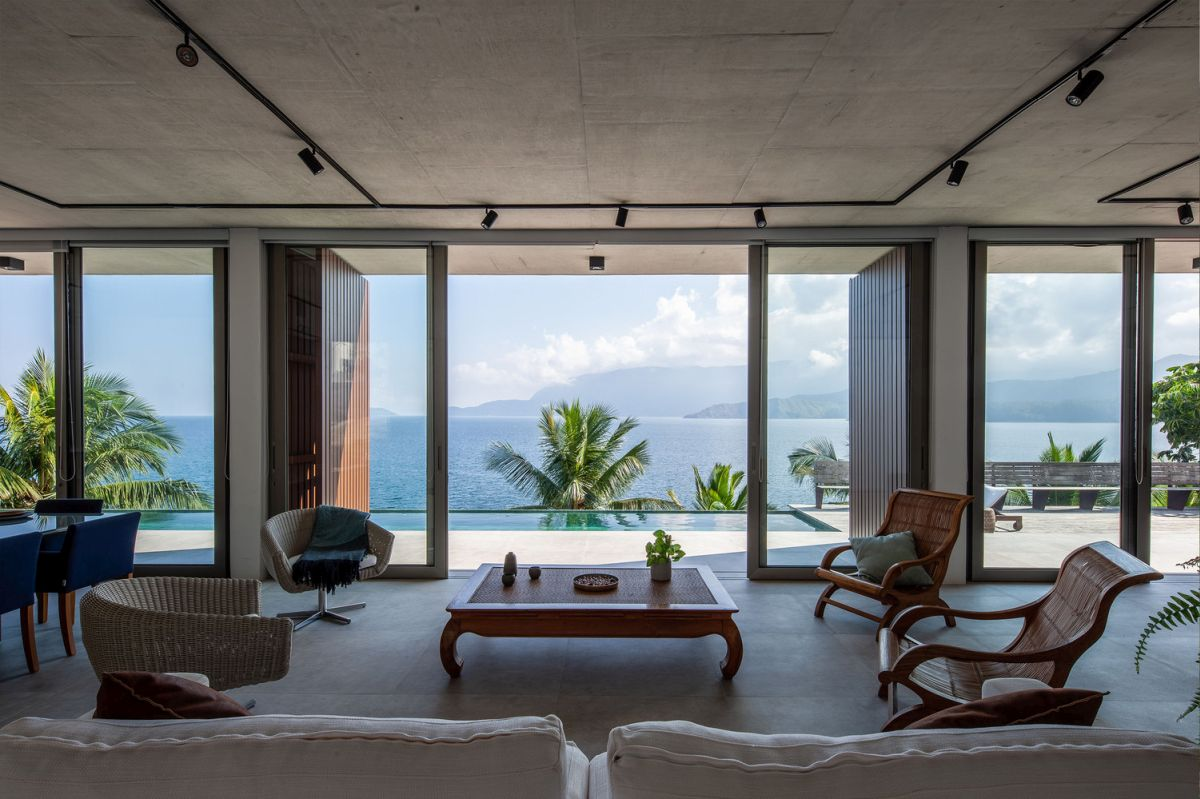 The living area features a large sitting area oriented towards the spectacular view
