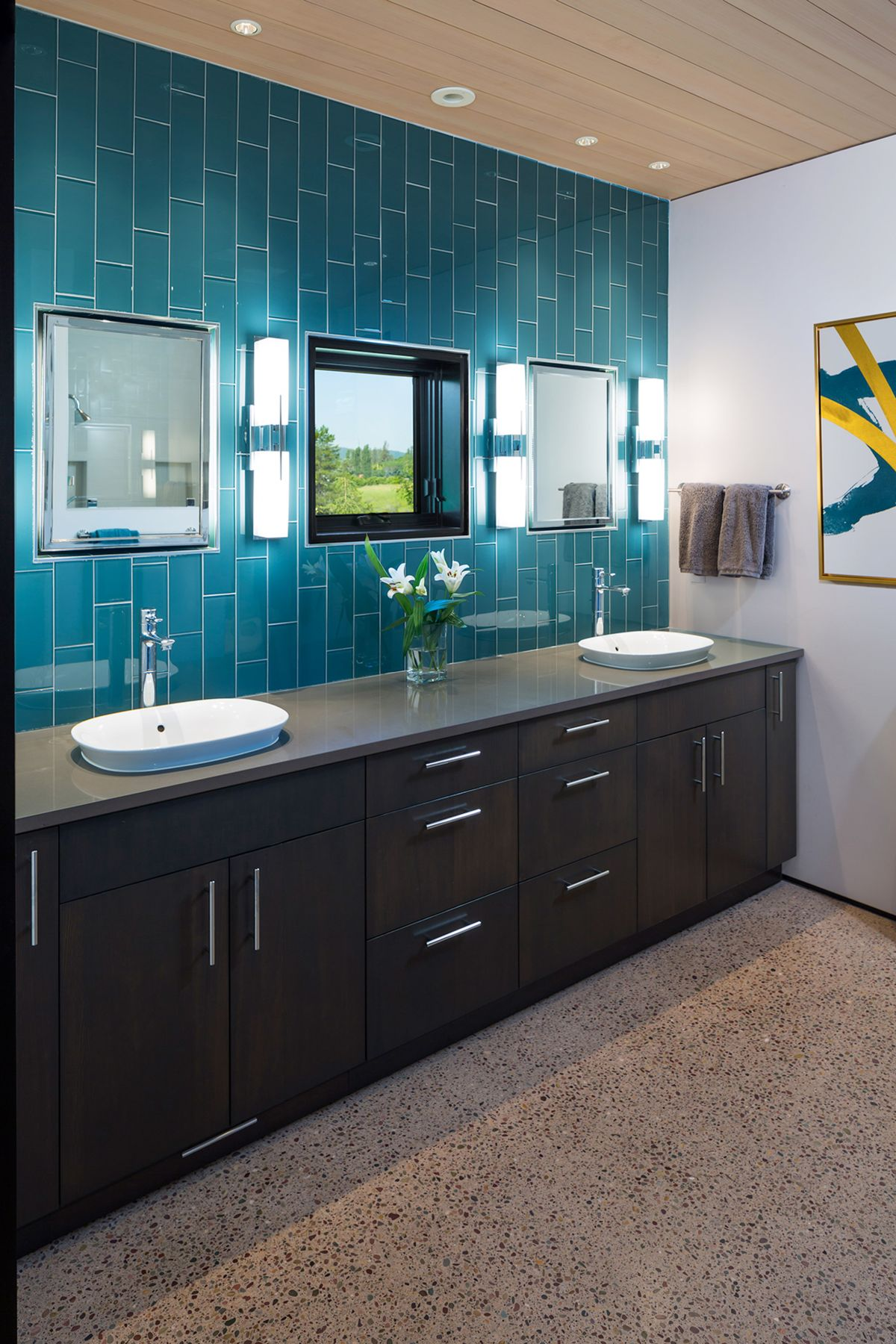 The main bathroom has the same turquoise accents as the kitchen