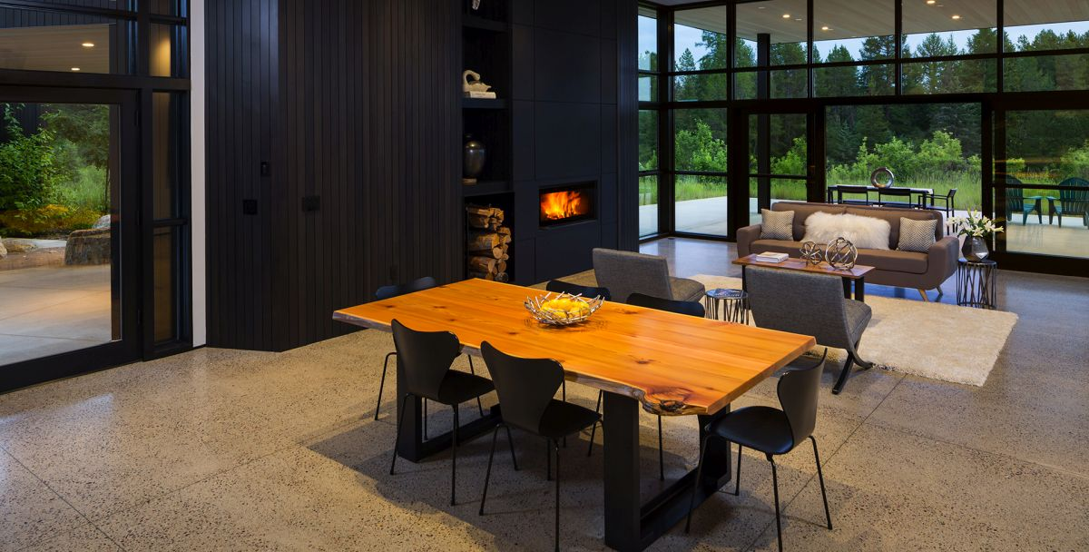 The wood-burning fireplace creates a very warm and welcoming ambiance in the living area