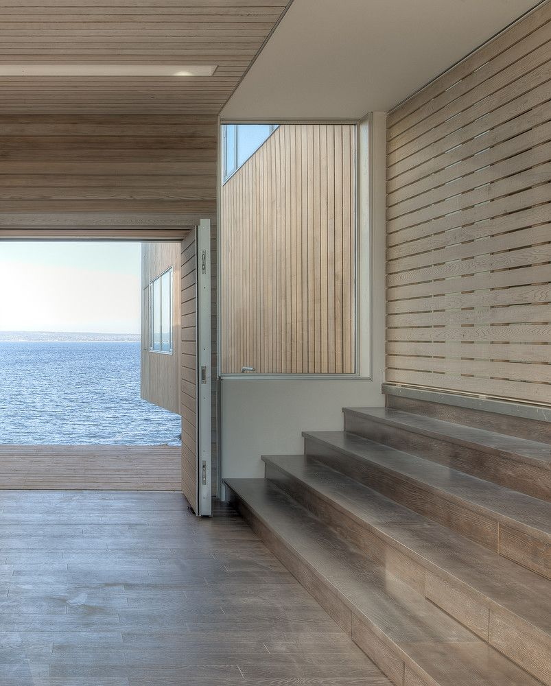 The entryway is a large transitional space with two sets of stairs leading to each of the two pavilions