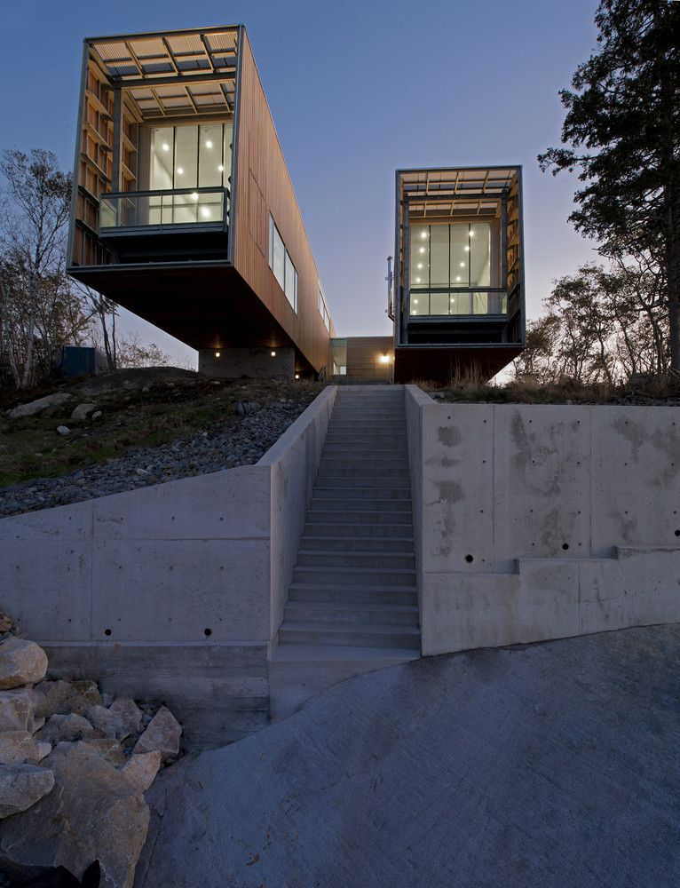 As the two pavilions extend over the landscape, a pathway opens up between them