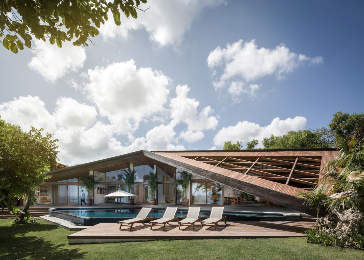 The unique, geometric roof extends the house beyond its internal boundaries
