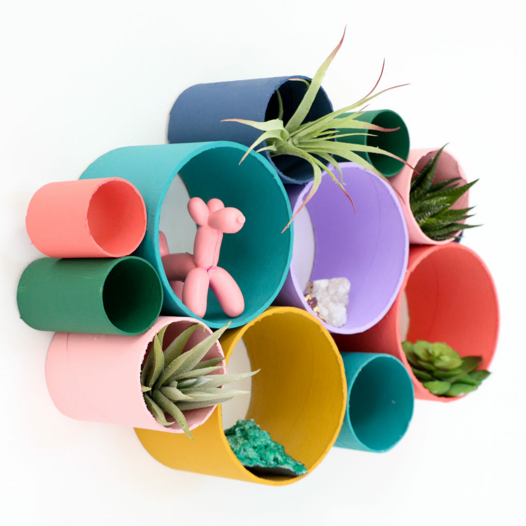 Colorful wall organizer made of tubes
