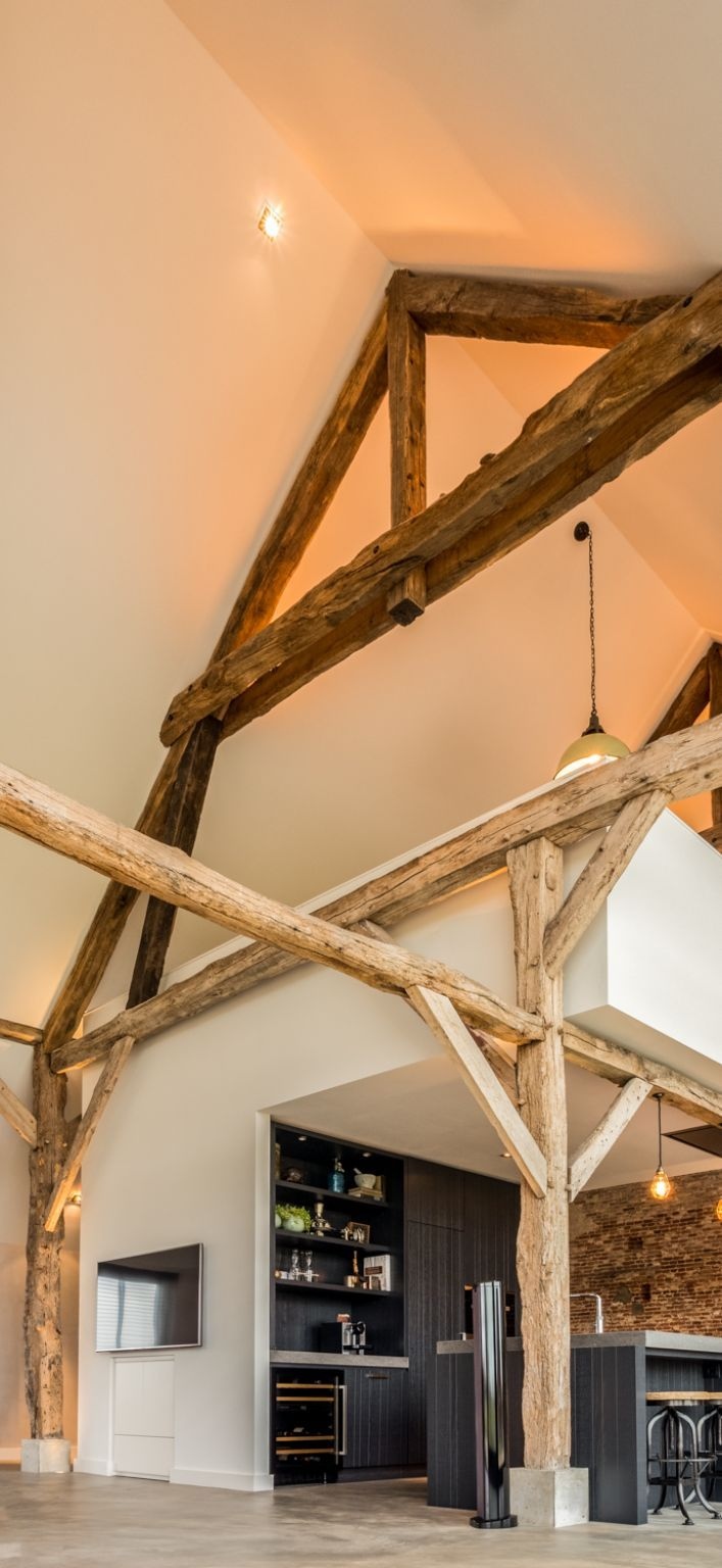 The rest of the walls have a clean white look which allows the wooden trusses to stand out even more