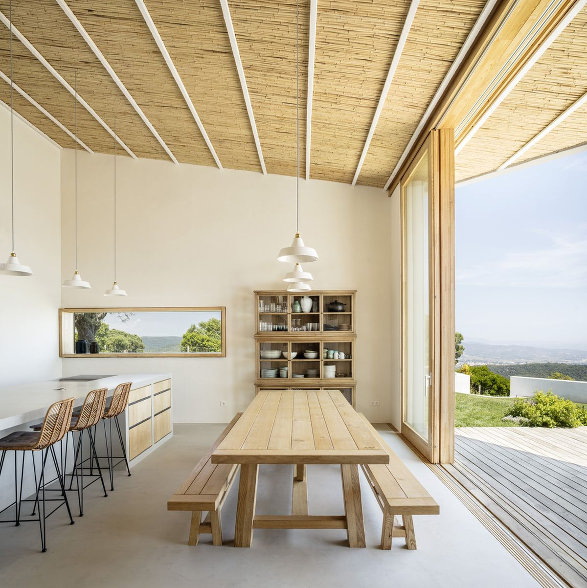 The kitchen and dining area share an open plan and are directly connected to the outdoors