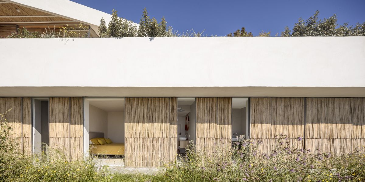 A series of sliding panels allow the interior spaces to open up towards the garden