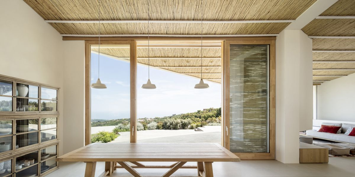 The sliding glass doors ensure a smooth and seamless transition between the interior spaces and the deck