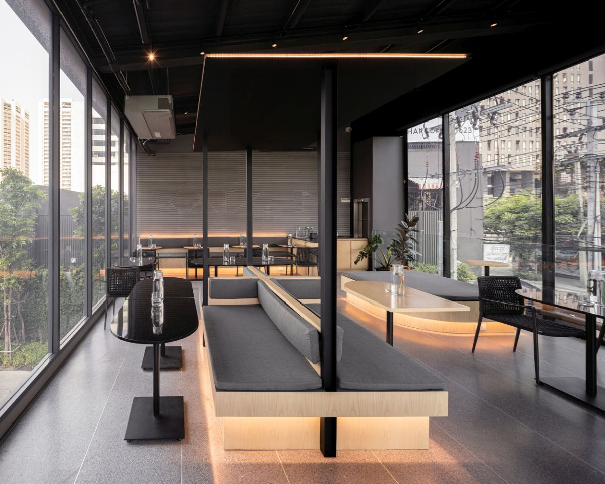The upstairs seating area features various types of configurations and a flexible furniture layout