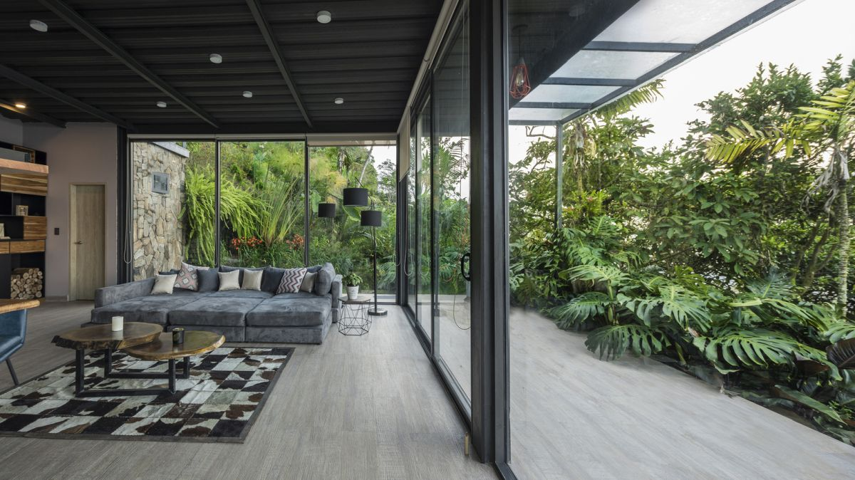 There's a cool juxtaposition between the indoor and the outdoor spaces thanks to the sliding glass doors that connect them