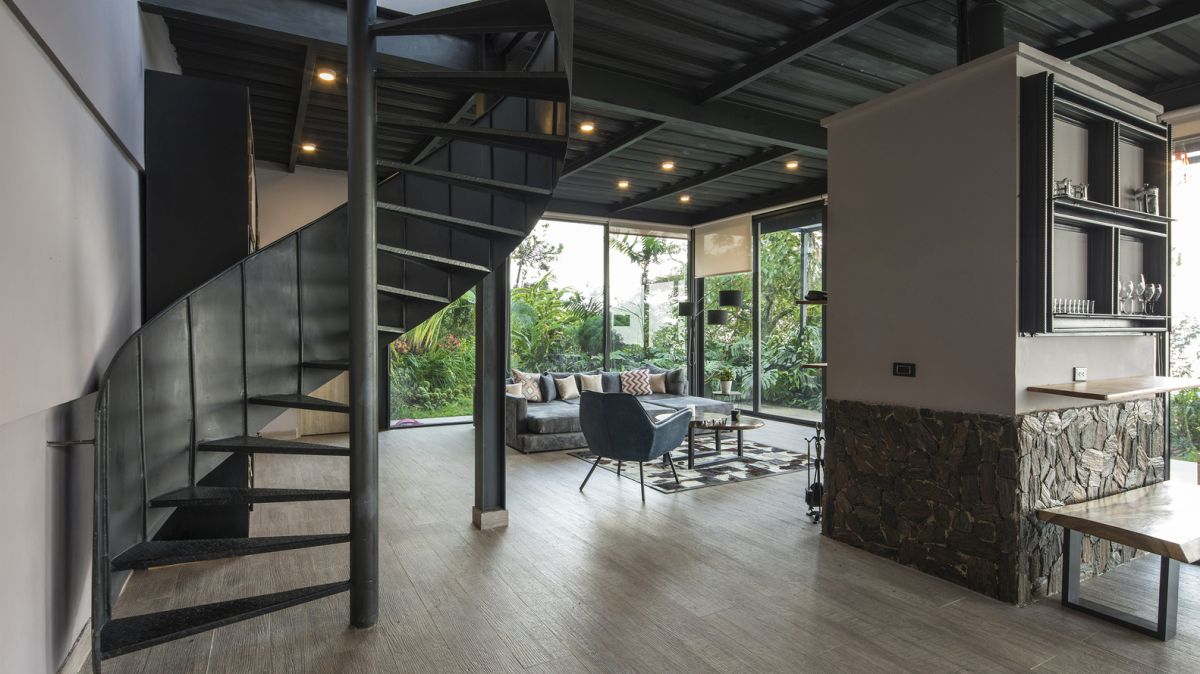 The interior spaces are organized on two floors which are connected by a spiral staircase