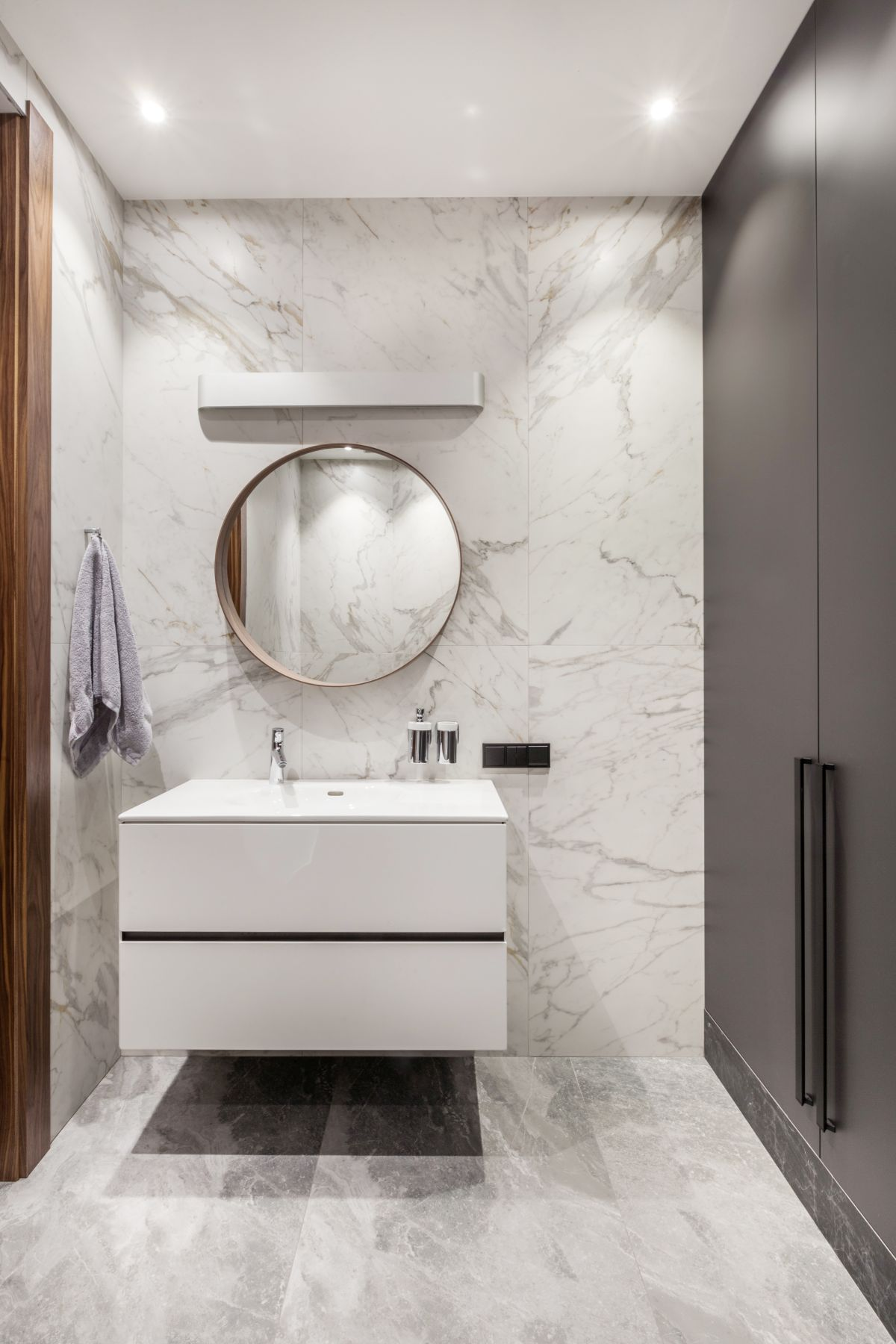 Marble really is timeless and this stylish powder room proves with its chic design and simplicity