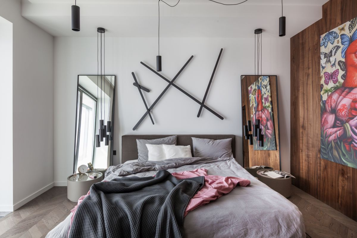 This is the bedroom, now with a chic and glamorous design that gives it an airy and open feel