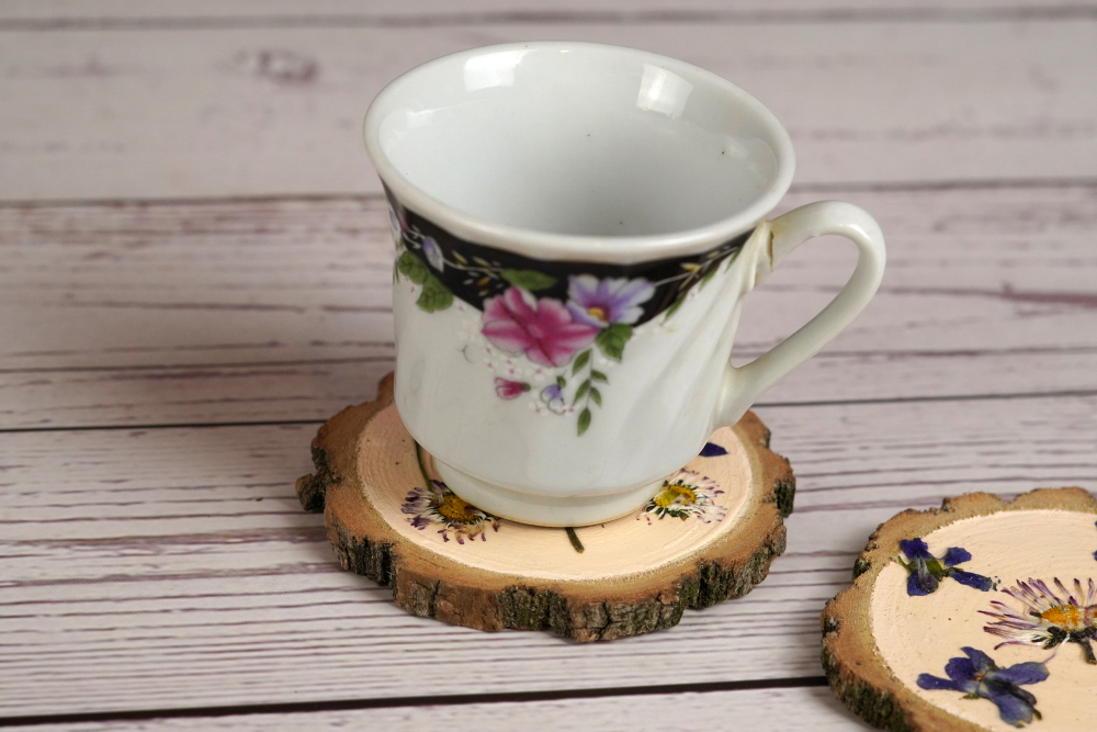 Wooden coasters decorated with pressed flowers